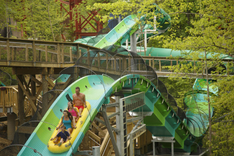 RiverRush at Dollywood's Splash Country is the first and only water coaster in the State of Tennessee and was awarded the Golden Ticket for best new water park attraction in 2013. Dollywood's Splash Country opens for the season May 17. (Photo: Business Wire)