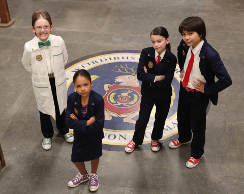 """PBS KIDS will premiere a new live-action series, ODD SQUAD, Wednesday, November 26, 2014. Pictured (left to right): Sean Michael Kyer (""""Agent Oscar""""), Millie Davis (""""Ms. O""""), Dalila Bela (""""Agent Olive"""") and Filip Geljo (""""Agent Otto""""). (Photo credit: ODD SQUAD (C) 2014 The Fred Rogers Company.)"""
