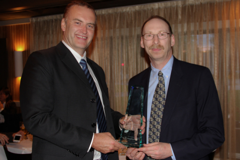 John Molloy, Divisional Chief Executive, TT Electronics-IMS, receives the Thermo Fisher Scientific Supplier of the Year Award from Peter Granick, Vice President of Global Sourcing for Thermo Fisher. (Photo: Business Wire)