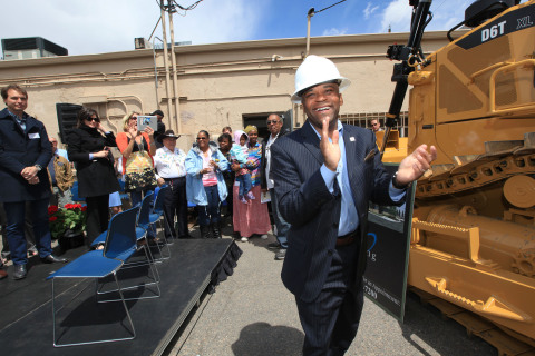 Denver Mayor Michael Hancock helps bulldoze hunger for the Metro CareRing groundbreaking of the new Hunger Relief Center at 18th & Downing in Denver. (Photo: Business Wire)