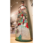 "This 13-foot-tall Coca-Cola bottle is a work of folk art and one of the newest additions to the Pop Culture gallery at the World of Coca-Cola in Atlanta. The exhibit, Howard Finster: Visions of Coca-Cola, opens today, featuring work by the self-taught artist and Baptist minister from Georgia. In this image, Finster used his one-of-a-kind style to depict historical figures on a bottle ""big enough for man to stand in."" This exhibit is part of the World of Coca-Cola's kickoff to summer, which includes a new short film, a new mobile app and a special ticket offer in celebration of its seventh anniversary. (Photo: Business Wire)"