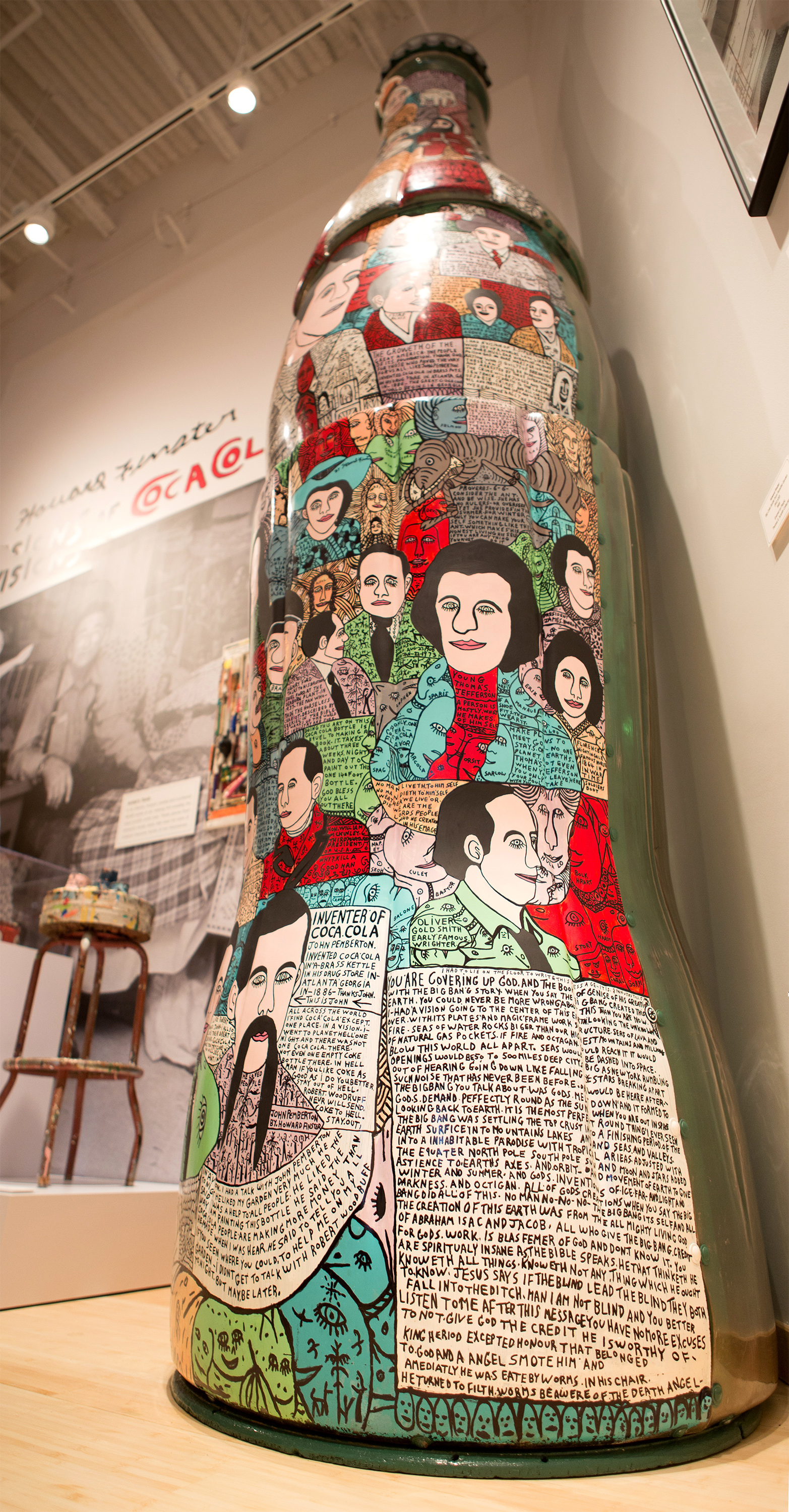 """This 13-foot-tall Coca-Cola bottle is a work of folk art and one of the newest additions to the Pop Culture gallery at the World of Coca-Cola in Atlanta. The exhibit, Howard Finster: Visions of Coca-Cola, opens today, featuring work by the self-taught artist and Baptist minister from Georgia. In this image, Finster used his one-of-a-kind style to depict historical figures on a bottle """"big enough for man to stand in."""" This exhibit is part of the World of Coca-Cola's kickoff to summer, which includes a new short film, a new mobile app and a special ticket offer in celebration of its seventh anniversary. (Photo: Business Wire)"""