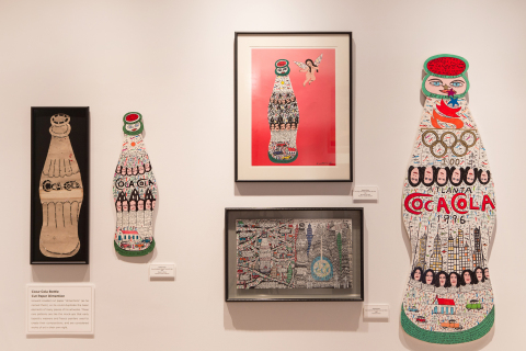 The World of Coca-Cola in Atlanta reveals a fresh new exhibit in its Pop Culture gallery today: Howard Finster: Visions of Coca-Cola. A famous self-taught folk artist, Baptist minister and Coca-Cola enthusiast, Finster incorporated the iconic contour bottle into much of his work. The exhibit includes several large folk art bottles, including this 8-foot tall piece he created for the 1996 Olympic Games. This exhibit is part of the World of Coca-Cola's kickoff to summer, which includes a new short film, a new mobile app and a special ticket offer in celebration of its seventh anniversary.  (Photo: Business Wire)