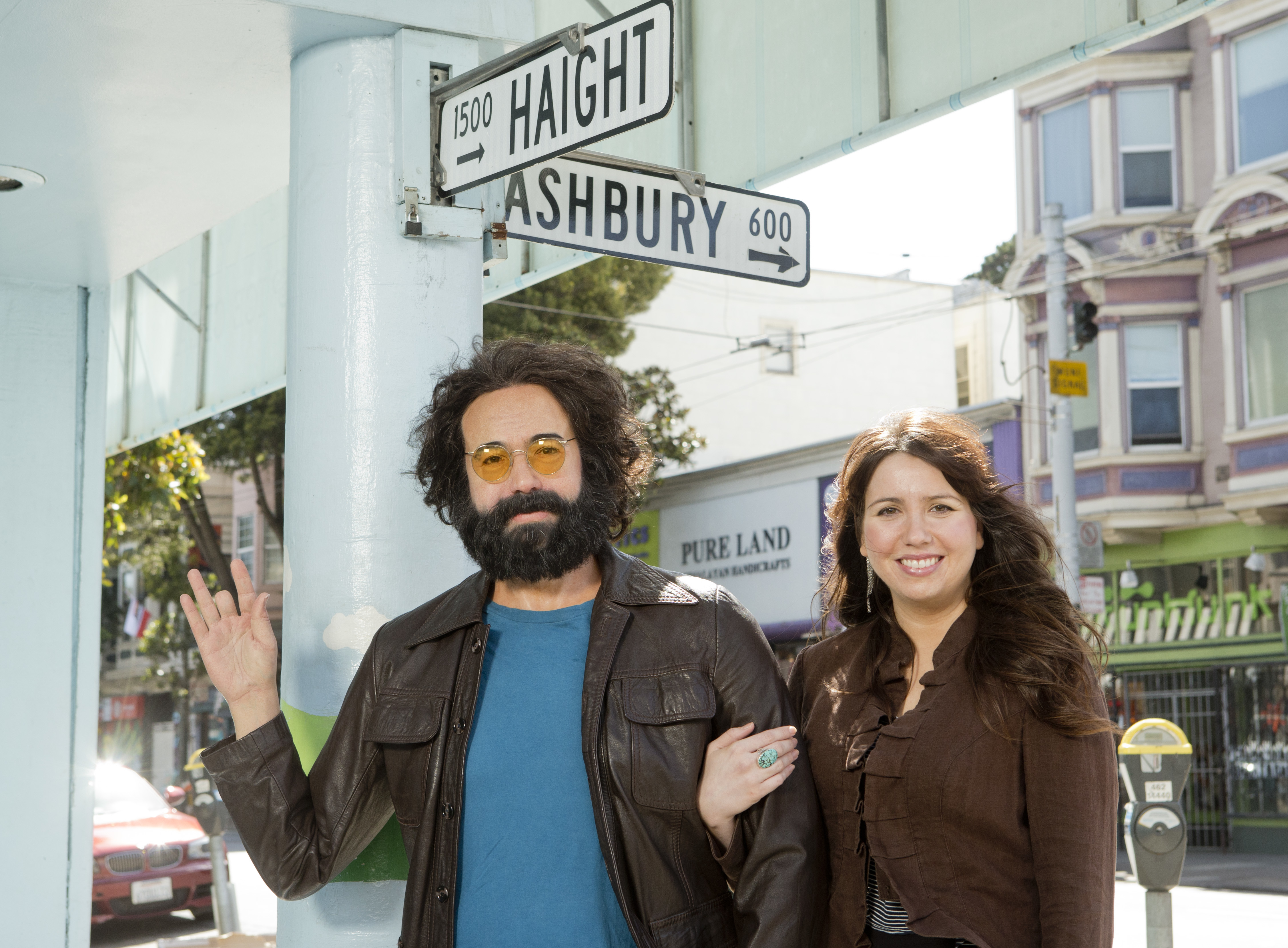 Keelin Garcia stands with a wax figure of her late father Jerry Garcia at the corner of Haight and Ashbury Streets in San Francisco, CA. (Beck Diefenbach / Madame Tussauds)
