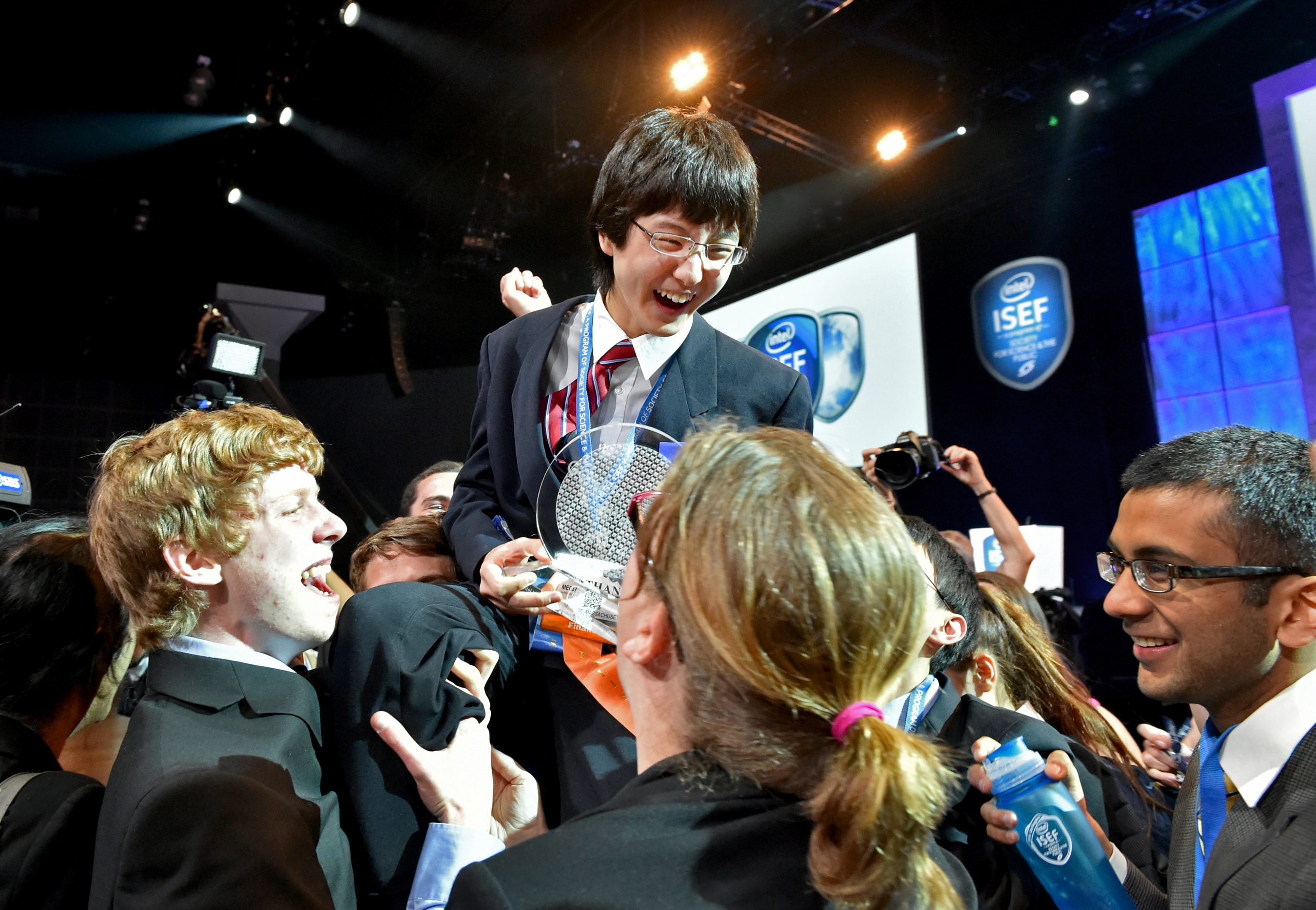 Nathan Han, 15, of Boston is celebrated by his fellow finalists for his first place win at the Intel International Science and Engineering Fair, the world's largest high school science research competition. More than 1,700 high schoolers from 70 countries, regions and territories competed for more than US$5 million in awards this week. PHOTO CREDIT: Intel/Chris Ayers.