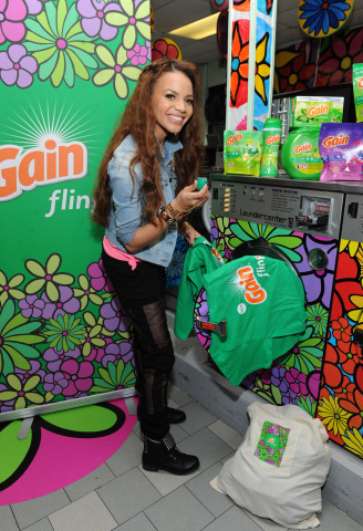 Latin Grammy nominated singer-songwriter Leslie Grace makes laundry joyful at the Gain #MusicToYourNose Laundromat Takeover, Friday, May 16, 2014, in the Bronx. Procter & Gamble's Gain partnered with Portraits of Hope to transform neighborhoods with community-created art displays. (Photo by Diane Bondareff/Invision for Gain)