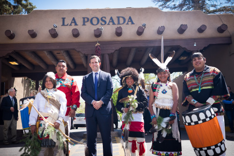 Joe Smith, (center) owner of La Posada de Santa Fe, with members of the Tesuque Pueblo at the flag celebration marking the hotel joining Starwood's The Luxury Collection of hotels. Travis Vigil, Tesuque Tribal Council Member, (left) offered a traditional Native American blessing on the hotel. (Photo: Business Wire)