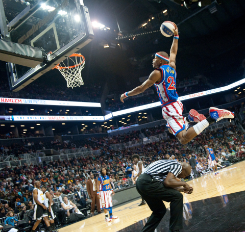 Globetrotter star Hacksaw Hall dunks over a referee. The Globetrotters announced an exclusive partnership this morning with The Whistle Network for YouTube content and management. (Photo: Business Wire)