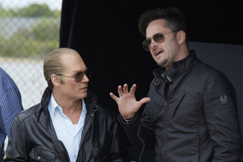 (L-r) JOHNNY DEPP as Whitey Bulger and director SCOTT COOPER on the set of the as-yet-untitled Whitey Bulger film, which has begun filming on location in Boston. Photo credit: Claire Folger