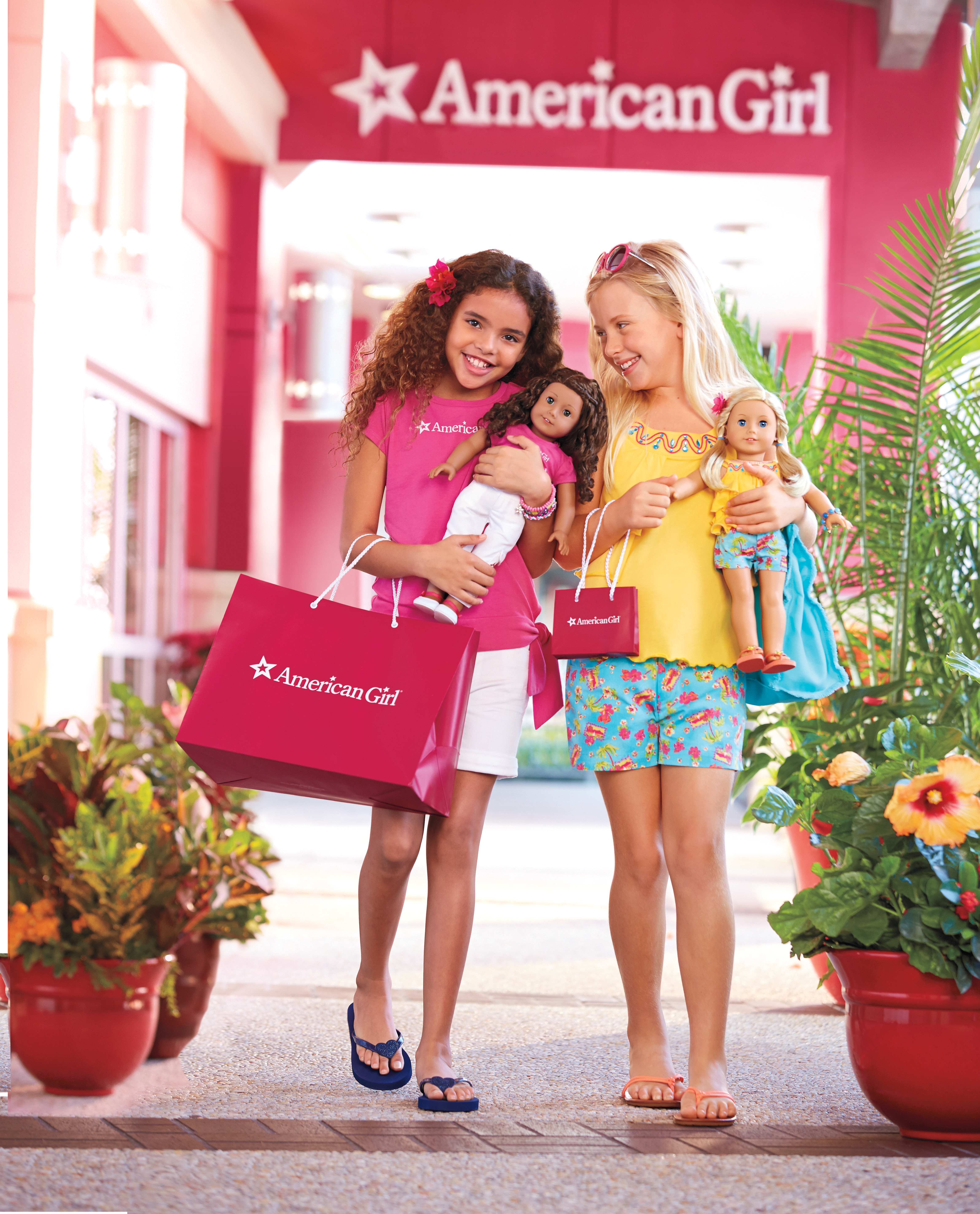 Girls enjoying a visit to an America Girl store. (Photo: Business Wire)