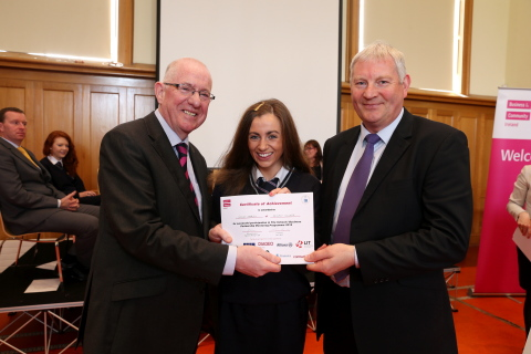 Minister for Children and Youth Affairs, Charles Flanagan T.D. (left) and John Everett, senior programmer, Pramerica (right) join BITCI participant Gillian Marley as she accepts her completion certificate.(Photo: Business Wire)