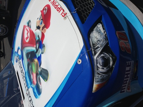On May 24 the worlds of Mario Kart and NASCAR collide when Matt Kenseth races in the Nationwide Series History 300 at Charlotte Motor Speedway in the No. 20 GameStop sponsored car featuring Mario Kart 8 graphics. (Photo: Business Wire)
