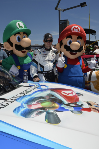 In this photo provided by Nintendo of America, NASCAR driver Matt Kenseth prepares to hit the Charlo ...
