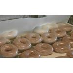 Broll of Krispy Kreme's signature Original Glazed being made and glazed.