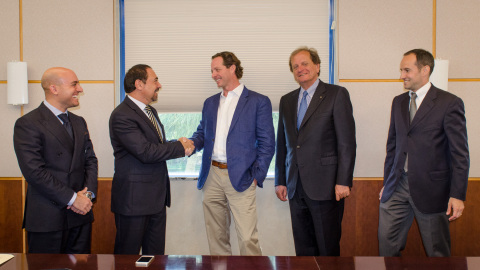 Mr. Luigi Di Geso, President and CEO of MAPEI Americas and Mr. Travis Collins, General Manager of GRT shake hands as acquisition is completed. (Photo: Business Wire)
