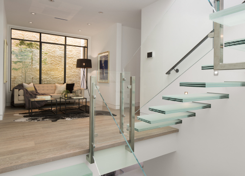 Floating glass cantilevered staircase inside Residence 2680 by Troon Pacific, Inc. (Photo: Business Wire)