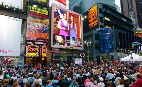 Scores of Broadway fans enjoy a past year's Tony Awards simulcast in Times Square hosted by Clear Channel Spectacolor (Photo: Business Wire)