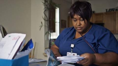 Tiffany Richardson struggles to pay her bills while she cares for her mother who was diagnosed with cancer. (Photo: Business Wire)