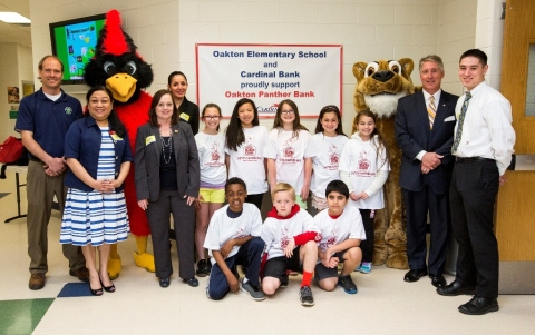 (L-R): Oakton Elementary School Assistant Principal Keith Eck; Cardinal Bank Fairfax Corner Banking Office Manager Kriti Rao; Senior Vice President & Regional Sales & Service Manager Karen Denas; Fairfax Corner Banking Office Assistant Manager Dina Azami; student banking officers representing Oakton Panther Bank; Cardinal Bank Regional President Kevin Reynolds and Fairfax Corner Banking Office Teller Ernest Patton (Photo: Galen Photography)