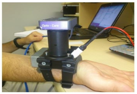 "The new glucose- and dehydration-monitoring ""watch,"" strapped to a subject's wrist and connected to  ..."