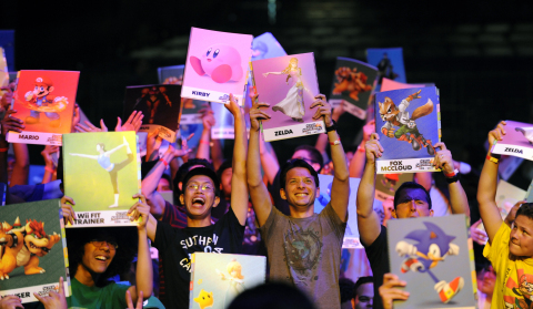 In this photo provided by Nintendo of America, audience members vote for their Fan Favorite contestant to move on to the next round of the Super Smash Bros. Invitational tournament at NOKIA Theatre L.A. LIVE in Los Angeles on June 10, 2014. (Photo: Business Wire)