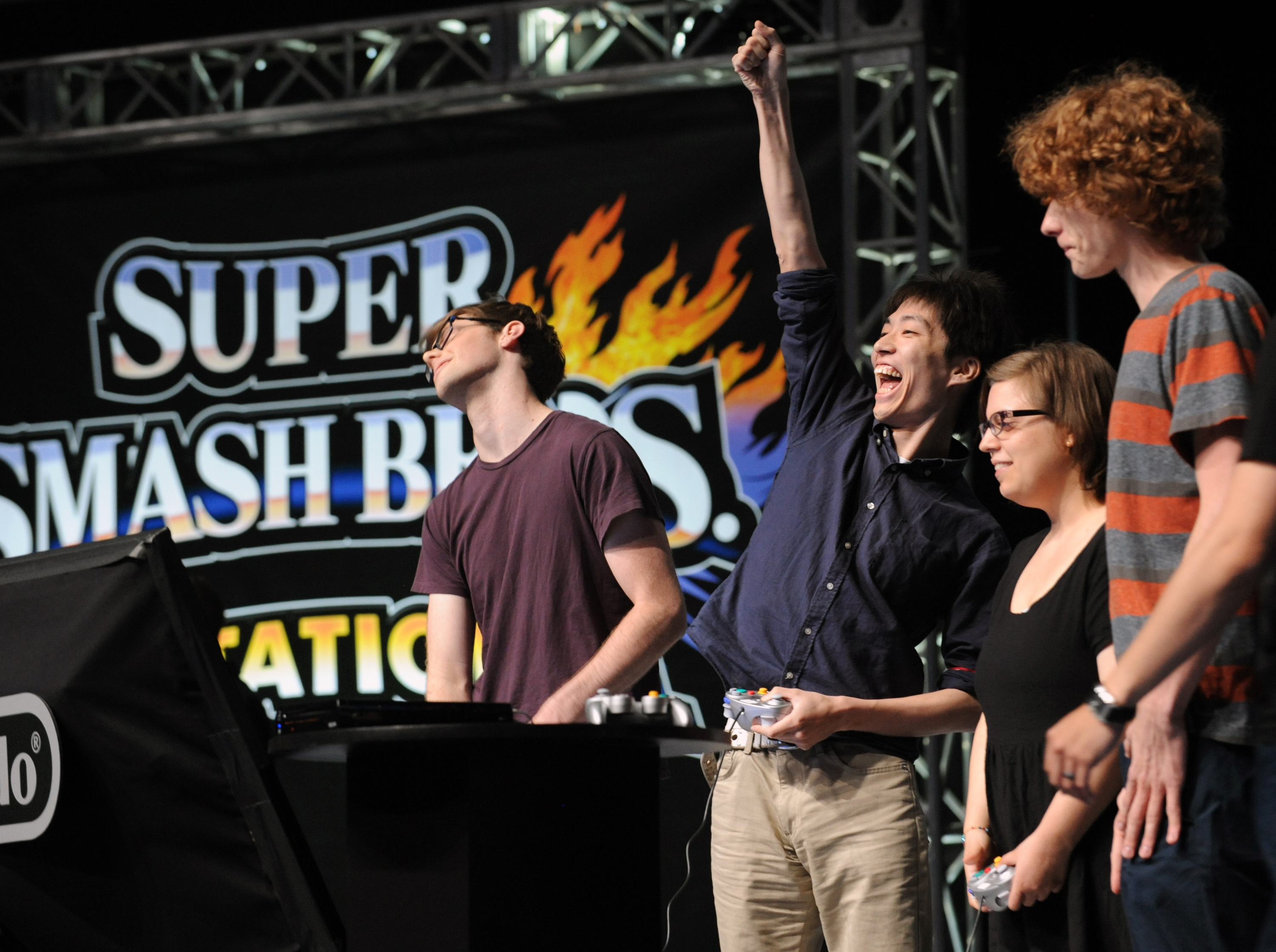 """In this photo provided by Nintendo of America, Masaya """"Amsa"""" Chikamoto of Japan celebrates a victory in a multiplayer battle at NOKIA Theatre L.A. LIVE in Los Angeles on June 10, 2014, to celebrate the upcoming launches of Nintendo's Super Smash Bros. video games for Nintendo 3DS and Wii U. Thousands of fans in the audience and countless more watching online witnessed new Super Smash Bros. characters clashing with existing favorites in action for the first time. (Photo: Business Wire)"""