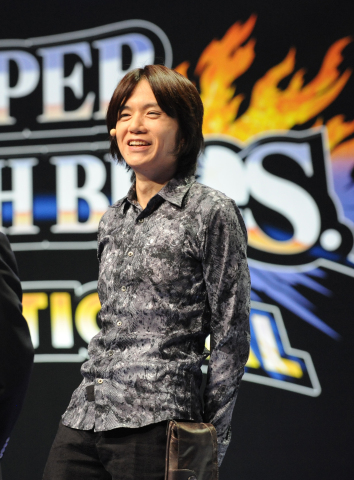 In this photo provided by Nintendo of America, Masahiro Sakurai, creator and director of the Super Smash Bros. series, welcomes the excited crowd at NOKIA Theatre L.A. LIVE and fans watching online to the Super Smash Bros. Invitational tournament at the E3 video game trade show in Los Angeles on June 10, 2014. (Photo: Business Wire)
