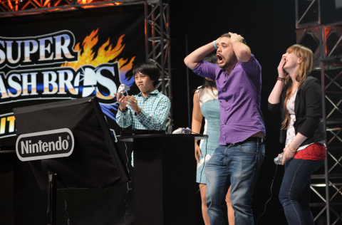 "In this photo provided by Nintendo of America, semi-finalist Juan ""Hungrybox"" Debiedma of Orlando, Florida reacts to a multiplayer battle at NOKIA Theatre L.A. LIVE in Los Angeles on June 10, 2014, to celebrate the upcoming launches of Nintendo's Super Smash Bros. video games for Nintendo 3DS and Wii U. Thousands of fans in the audience and countless more watching online witnessed new Super Smash Bros. characters clashing with existing favorites in action for the first time. (Photo: Business Wire)"