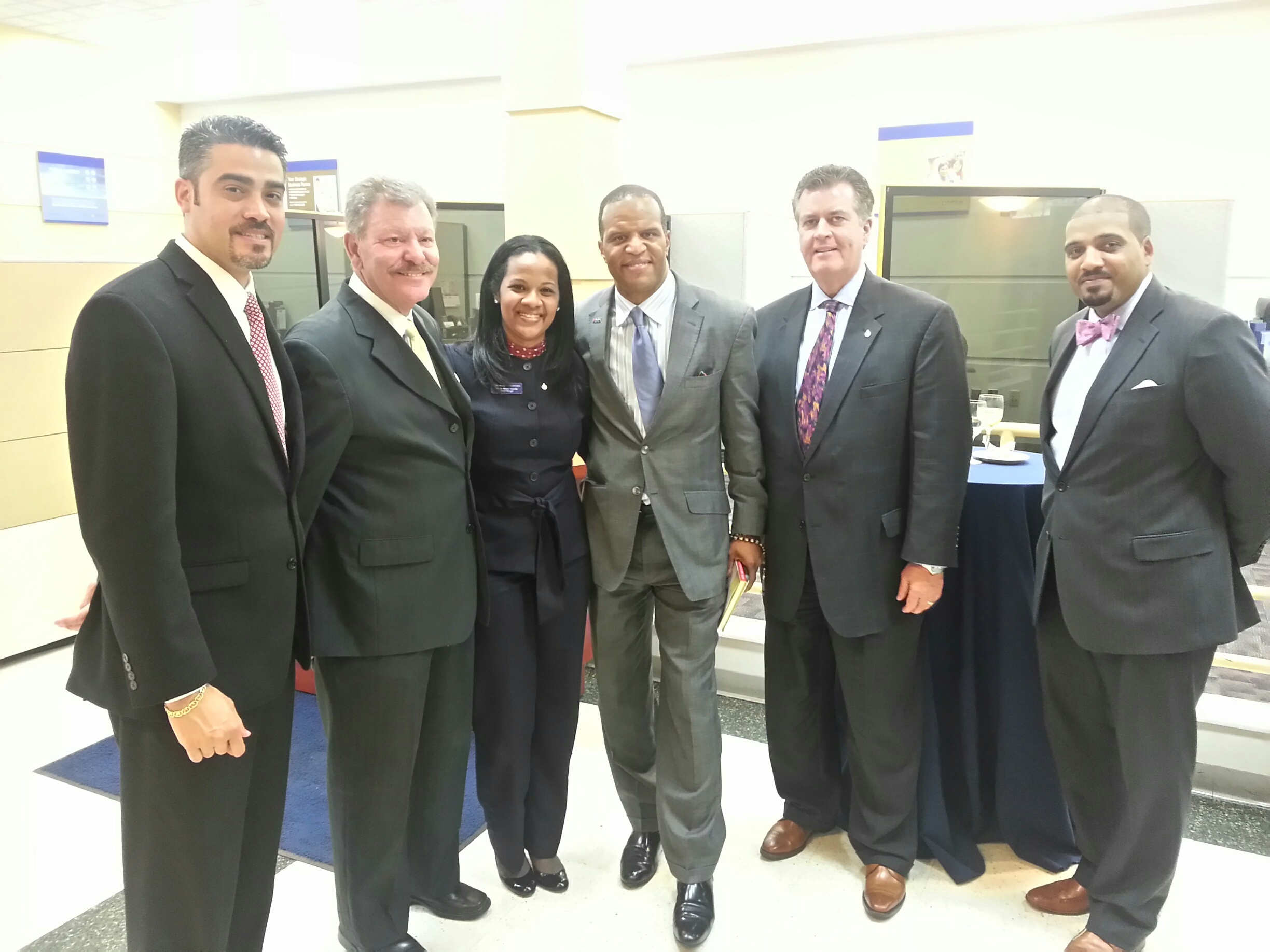 Helping people succeed financially to make our communities stronger. Pictured left to right: Rafael Sanchez, PCB Retail Manager, Manhattan North, Bronx & Queens; Lenny Caro, President of the Bronx Chamber of Commerce; Wanda Matos, PCB East Tremont Branch Manager; John Hope Bryant, Founder, Chairman and CEO, Operation HOPE, Inc.; Brian Doran, NY Metro Region Executive, PCB; Robert Hernandez, PCB Commercial Relationship Officer (Photo: Business Wire)