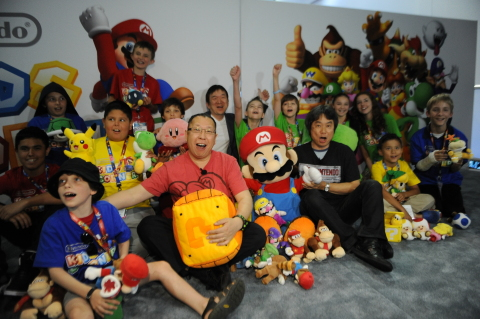 In this photo provided by Nintendo of America, a select group of kids enjoy meeting video game lumin ...