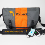Vor-Power(TM) flexible battery strap being used on a messenger bag to charge smart phones. (Photo: Vorbeck Materials Corp.)