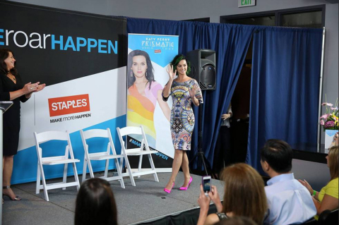 """Global pop music superstar Katy Perry speaks about the importance of teachers and education the need to """"Make Roar Happen"""" through a new partnership with Staples at a press conference held at NOKIA Theatre L.A. Live on Thursday, June 12th, 2014. As part of this partnership, Staples is continuing its commitment to education by donating $1 million dollars to DonorsChoose.org to support classroom projects. (Photo by Matt Sayles/Invision for Staples/AP Images)"""
