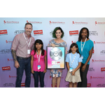 "Katy Perry poses with students and teachers from local LA elementary schools at the Staples ""Make Roar Happen"" press conference held on Thursday, June 12th, 2014 at NOKIA Theatre L.A. Live. Staples continued its commitment to education by donating $1 million dollars to DonorsChoose.org to support classroom projects. (Photo by Matt Sayles/Invision for Staples/AP Images)"