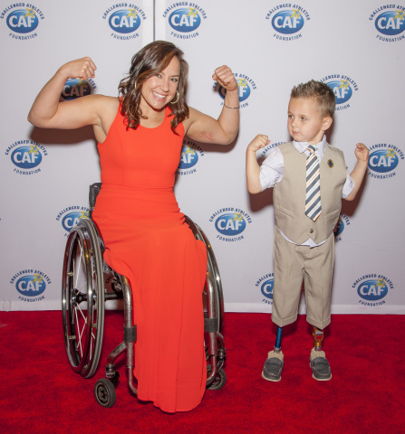 """CAF athletes Alana Nichols and Braylon O'Neill show their strength at the 2014 """"A Celebration of Heroes, Heart and Hope gala in New York City. (Photo: Business Wire)"""