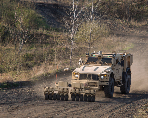 The Oshkosh® M-ATV equipped with TerraMax UGV and a mine roller (pictured) is capable of autonomous navigation for route clearance missions. (Photo: Business Wire)