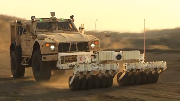The Oshkosh® M-ATV equipped with TerraMax UGV and a mine roller (pictured) is capable of autonomous navigation for route clearance missions.
