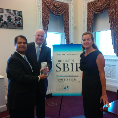 Ajay Malshe and Jim Phillips with EPA Program Manager April Richards (Photo: Business Wire)