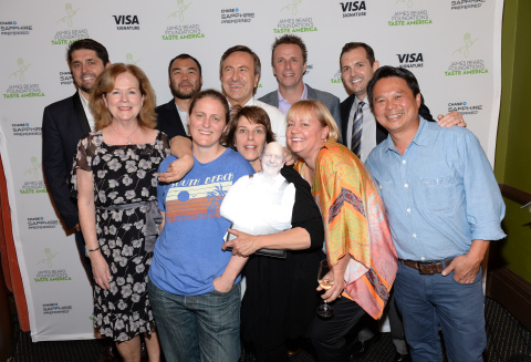 """Chefs, from left, Ludo Lefebvre, Paul Qui, April Bloomfield, Daniel Boulud, Barbara Lynch, Marc Murphy, Sherry Yard and Charles Phan pose with James Beard Foundation president Susan Ungaro, far left, and business director Chase Sapphire Preferred Jeff Bedard, back right, at the kick-off event for the James Beard Foundation's """"Taste America"""" national epicurean tour presented by Chase Sapphire Preferred Visa Signature at the James Beard House on Tuesday, June 17, 2014 in New York. (Photo by Evan Agostini/Invision for Chase Sapphire Preferred/AP Images)"""
