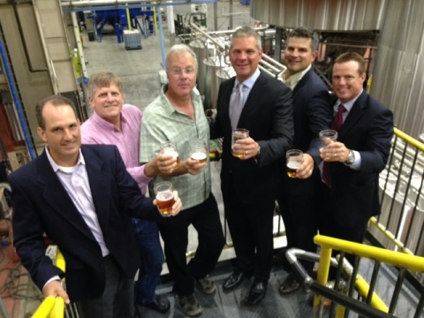 The GE Capital and Lagunitas team celebrate the opening of the Lagunitas facility June 17th. From left to right: Mike Dallape - Senior Vice President GE Capital Food & Beverage Group; Leon Sharyon - CFO Lagunitas Brewing Company; Tony Magee - CEO and Founder Lagunitas Brewing Company; Trevor Schauenberg - President & CEO GE Capital, Corporate Finance; Colin Guheen - SVP Risk- Food, Beverage & Agribusiness Investments; Eric Dusch - Chief Commercial Officer GE Capital, CF Equipment Finance.  (Photo: Business Wire)