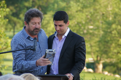 Al Berg (left), CEO of Marchon Eyewear and Vice President of the MIY JCC's Board of Directors, presented Mr. Joshua Sason with a handcrafted Tzedakah box in honor of his key role in the continued success and growth of the organization. (Photo: Business Wire)