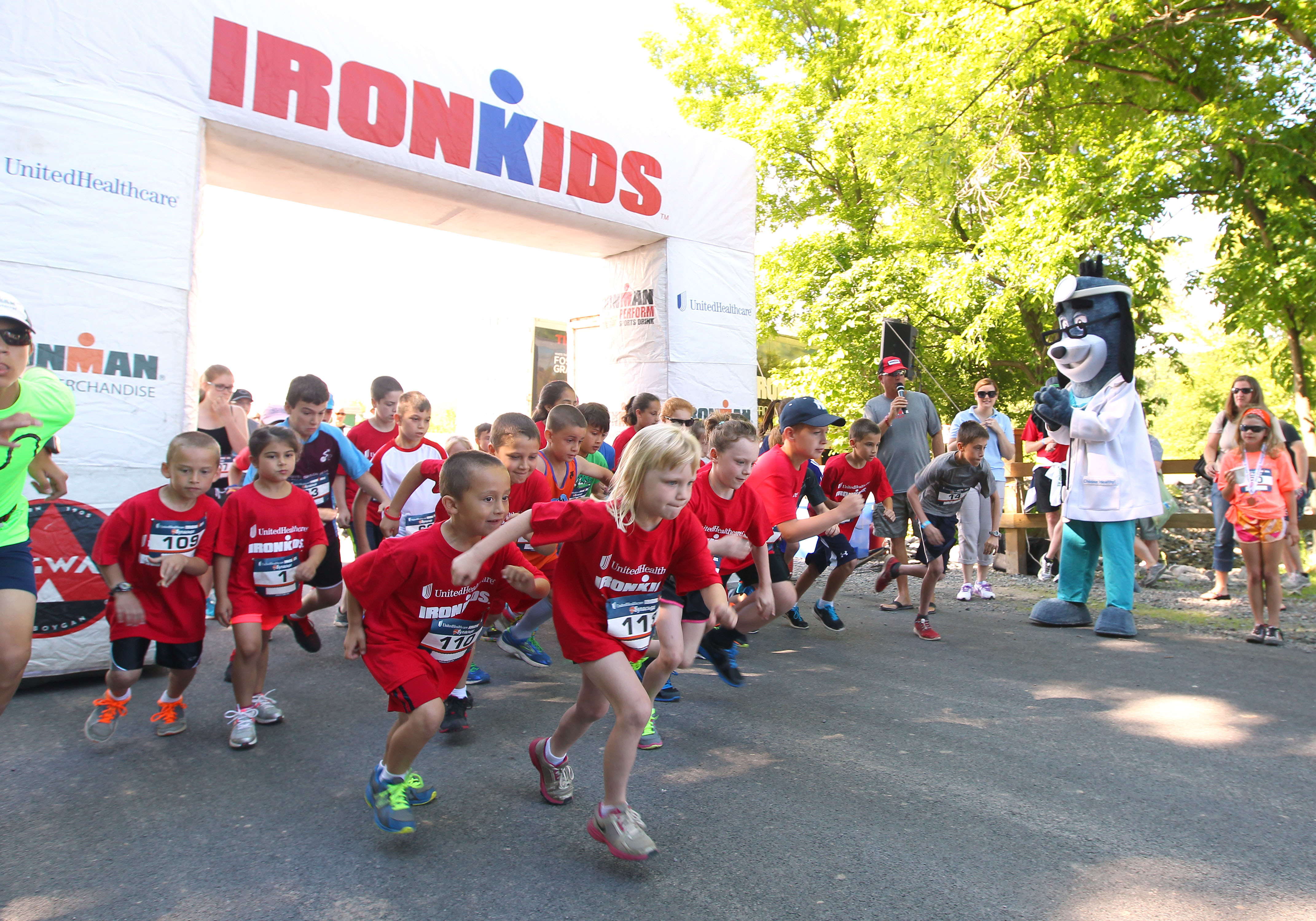 "UnitedHealthcare mascot Dr. Health E. Hound is pictured at the finish line of the UnitedHealthcare IRONKIDS Syracuse Fun Run at Jamesville Beach Park today. Nearly 100 youth participated in the race for ""triathletes to be."" Photo Credit: Michael J. Okoniewski"