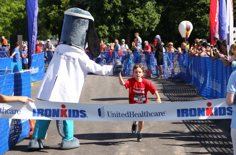 UnitedHealthcare's mascot Dr. Health E. Hound cheers on youth as they run the ¼ mile course at today ...