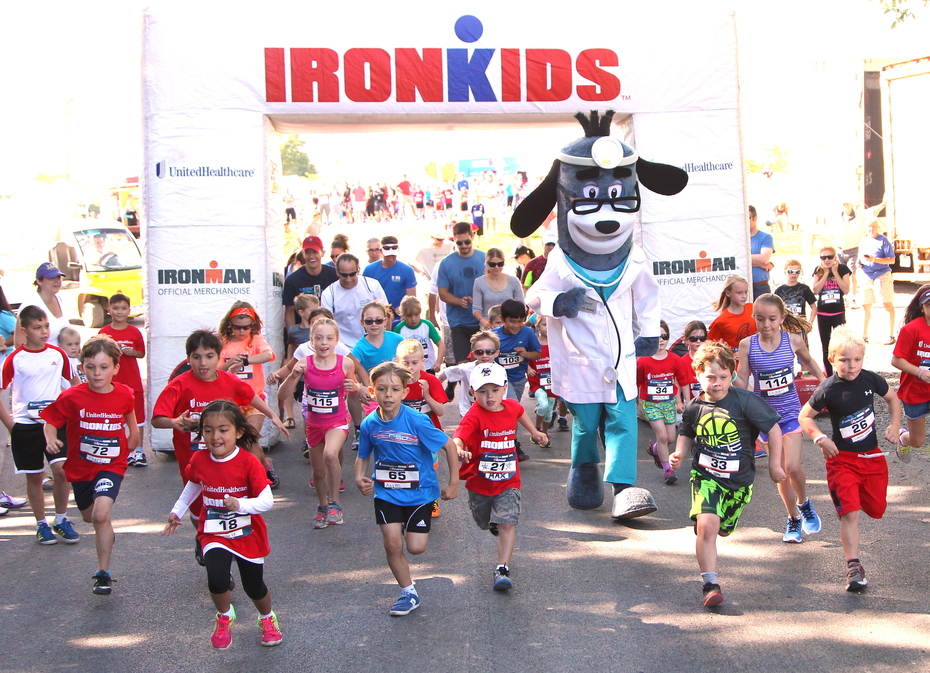 UnitedHealthcare's mascot Dr. Health E. Hound runs with youth on the ½ mile course at today's UnitedHealthcare IRONKIDS Syracuse Fun Run at Jamesville Beach Park. Photo Credit: Michael J. Okoniewski