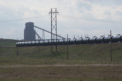 A crude oil unit train arrives for loading at Meritage Midstream's Black Thunder Terminal. Situated in the heart of the Powder River Basin, the terminal is located at Arch Coal's Black Thunder mining complex. One of the mine's high-speed coal loadouts is visible in the background. (Photo: Business Wire)