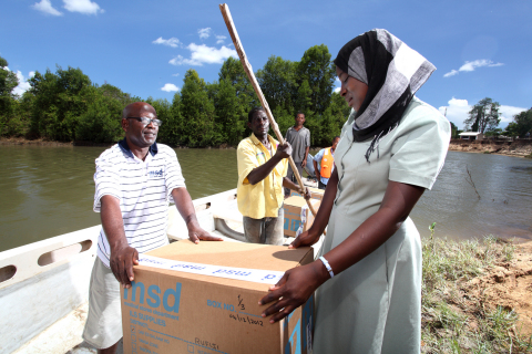 The Medical Stores Department (MSD) in Tanzania delivers medicines to a clinic via boat in the Rafij ...