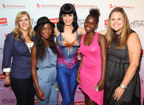 Local students Assima Egbame (left) and  Shavel Proctor (right) and their teachers Julie Rukavina (left) and Michelle Lee (right) backstage at the Verizon Center with Katy Perry after her Prismatic World Tour performance on Tuesday, June 24, 2014, in Washington, DC. As part of its $1 million dollar donation to online charity DonorsChoose.org, Staples, Inc. announced that it has fully funded the balance of every project that was on DonorsChoose.org in the Washington, D.C. community. This $43,994 donation helped 47 teachers fulfill classroom needs and helped more than 3,900 students in the D.C. public school district. Katy Perry teamed up with Staples, Inc. and DonorsChoose.org to 'Make Roar Happen' and support teachers during this back-to-school season. (Photo by Paul Morigi/Invision for Staples/AP Images)