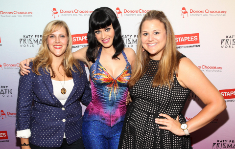 Local teachers Julie Rukavina (left) and Michelle Lee (right) backstage at the Verizon Center with Katy Perry after her Prismatic World Tour performance on Tuesday, June 24, 2014, in Washington, DC. As part of its $1 million dollar donation to online charity DonorsChoose.org, Staples, Inc. announced that it has fully funded the balance of every project that was on DonorsChoose.org in the Washington, D.C. community. This $43,994 donation helped 47 teachers fulfill classroom needs and helped more than 3,900 students in the D.C. public school district. Katy Perry teamed up with Staples, Inc. and DonorsChoose.org to 'Make Roar Happen' and support teachers during this back-to-school season. (Photo by Paul Morigi/Invision for Staples/AP Images)