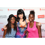 Local students Assima Egbame (left) and  Shavel Proctor (right) backstage at the Verizon Center with Katy Perry after her Prismatic World Tour performance on Tuesday, June 24, 2014, in Washington, DC. As part of its $1 million dollar donation to online charity DonorsChoose.org, Staples, Inc. announced that it has fully funded the balance of every project that was on DonorsChoose.org in the Washington, D.C. community. This $43,994 donation helped 47 teachers fulfill classroom needs and helped more than 3,900 students in the D.C. public school district. Katy Perry teamed up with Staples, Inc. and DonorsChoose.org to 'Make Roar Happen' and support teachers during this back-to-school season. (Photo by Paul Morigi/Invision for Staples/AP Images)
