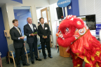 Michael McGuire, CEO of UnitedHealthcare New York and New Jersey; Jeff Alter, national CEO of UnitedHealthcare Employer & Individual; and Chris Law, national vice president of UnitedHealthcare Asian Initiatives (left to right) watch a Chinese lion dance as part of the 20th anniversary celebration of UnitedHealthcare Asian Initiatives and the establishment of its first retail store in New York's Chinatown that has served thousands of Asian Americans in New York and New Jersey. The event was held at UnitedHealthcare's 168 Centre Street in Chinatown at its Asian Initiative consumer support center (PHOTO: Gerard Gaskin, Gaskin Photography).