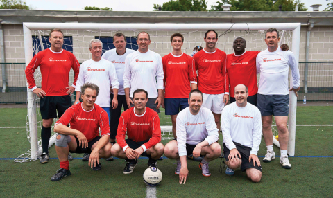 Geert Follens, President of Vacuum Solutions Division, pictured 4th from left, back row, with management and staff from Edwards who took part in a charity football match. (Photo: Business Wire)